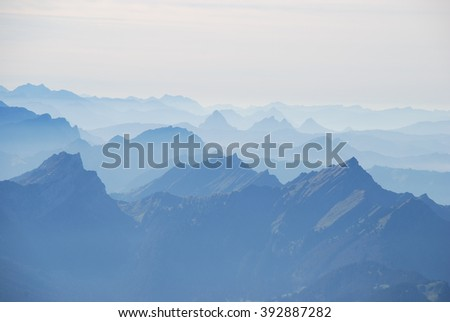 Misty mountain range Swiss alps - stock photo
