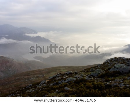 Misty mountains from the north of Portugal at dawn seeing a river
