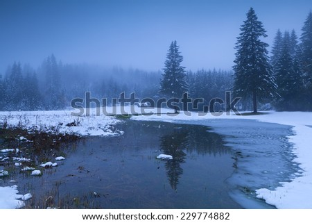 misty winter dusk in Alps, Bavaria, Germany - stock photo
