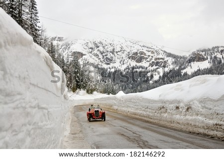 MISURINA, ITALY - FEBRUARY 21: A red Fiat 508 Sport Ghia starts the WinteRace classic car race on February 21, 2014 in Misurina. This car was built in 1932.