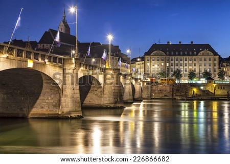 Mittlere bridge over Rhine river at sunset, Basel, Switzerland - stock photo