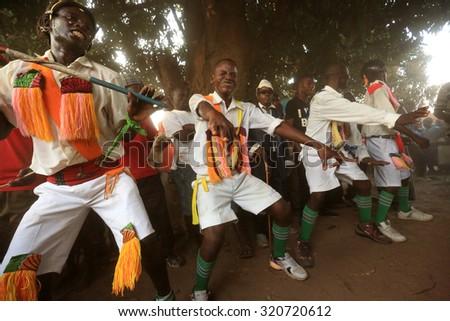 MITUNDU - MALAWI - JULY 25, 2015: Unidentified traditional Malipenga dancers at a Gule Wamkulu ceremony on July 25, 2015 in the village Mitundu near Lilongwe, Malawi - stock photo