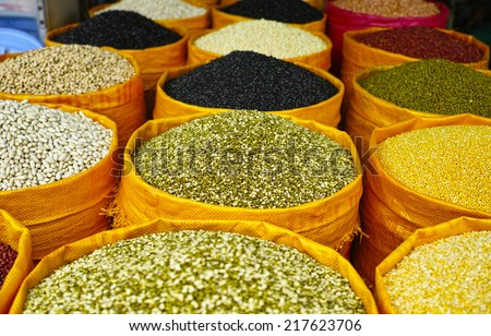 Mix beans and lentils , black eyed peas, soya bean, mung bean, azuki, beans in bags sell in the market - stock photo