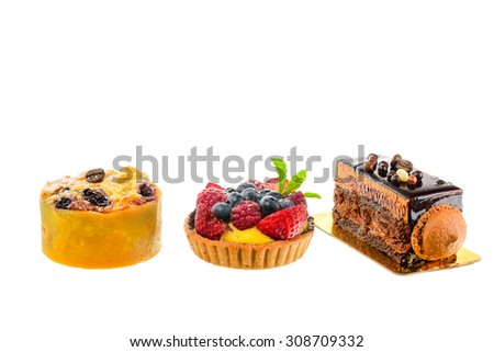 Mix berry tart and coffee cake slice on white background - stock photo
