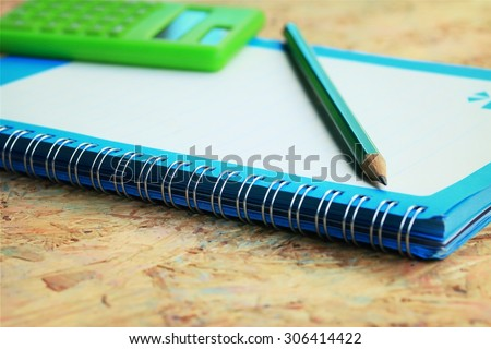 Mix book and calculator, stapler, tape, paper punch, pencil, scissors for office