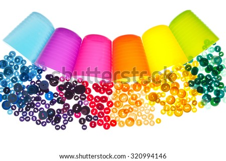 Mix buttons scattered on a white background. - stock photo