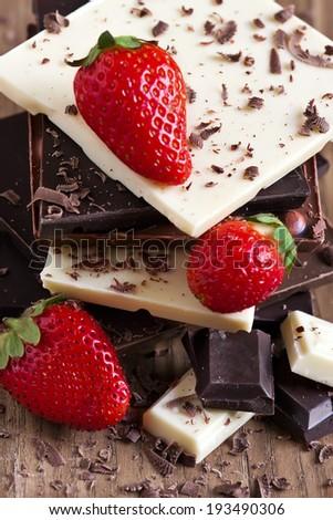 Mix chocolate tower with ripe strawberry. - stock photo