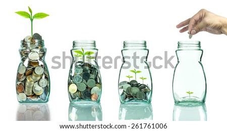 Mix coins and seed in clear bottle on white background,Business investment growth concept - stock photo