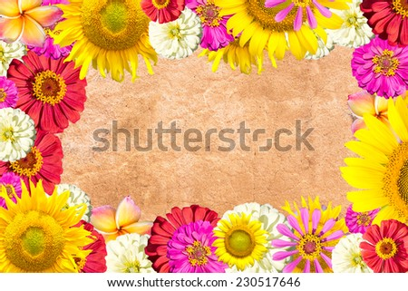 mix flowers frame on brick background