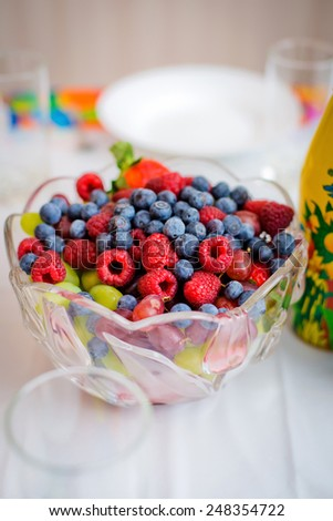 Mix fresh berries on a plate - stock photo