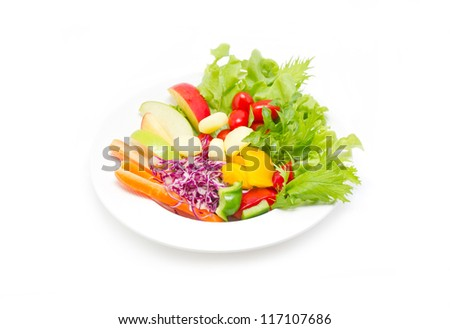 Mix fresh vegetables in plate isolated on white background.