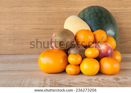 mix fruit on wood background - stock photo