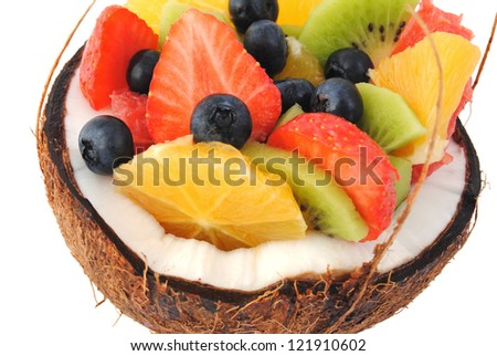 Mix fruit salad closeup, isolated white background. Healthy eating, dieting concept. - stock photo