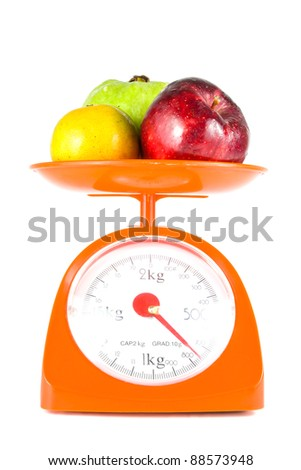 mix fruits lying on weight scale
