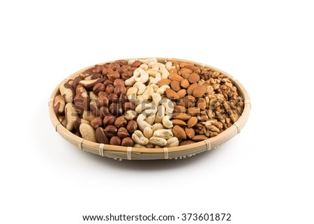 Mix nuts in wicker basket isolated on white background - stock photo