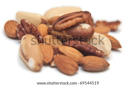 Mix of almonds, walnuts isolated on white - stock photo