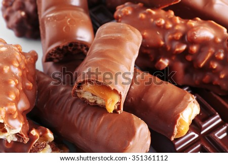 Mix of chocolate bars on table, close-up
