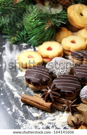 Mix of Christmas cookies with cinnamon, chocolate glaze and coconut - stock photo