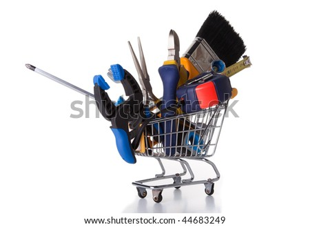 mix of construction tools inside a shopping cart (isolated on white) - stock photo
