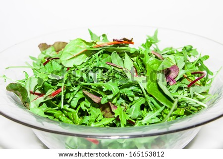 Mix of different varieties of lettuce (spinach, chard, Biondi, arugula, lettuce) on white background - stock photo