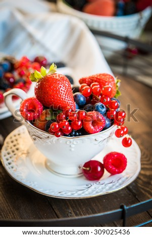 Mix of fresh berries in a cup of tea