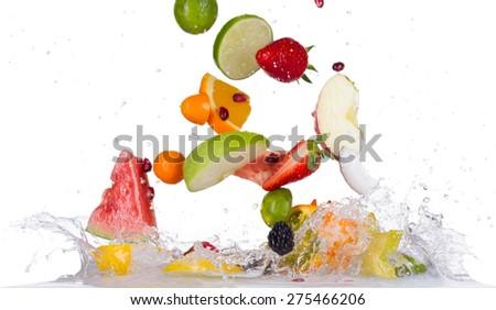 Mix of fresh fruit with water splashes isolated on white background - stock photo