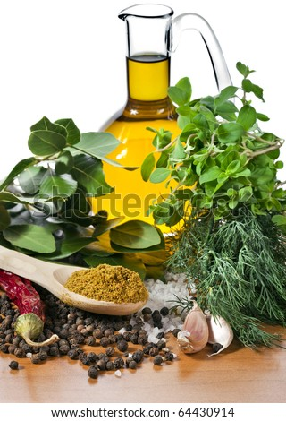 Mix of Fresh herbs and spices isolated on white - stock photo