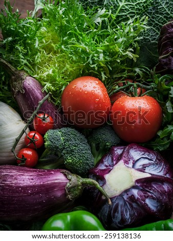 Mix of Fresh vegetables in wooden box : eggplants, cabbage and tomatoes - stock photo