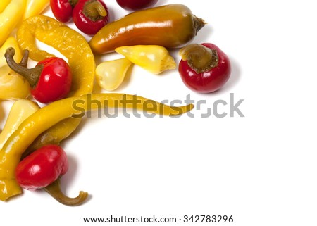 Mix of hot pickled peppers isolated on white background. Food background with copy space. - stock photo