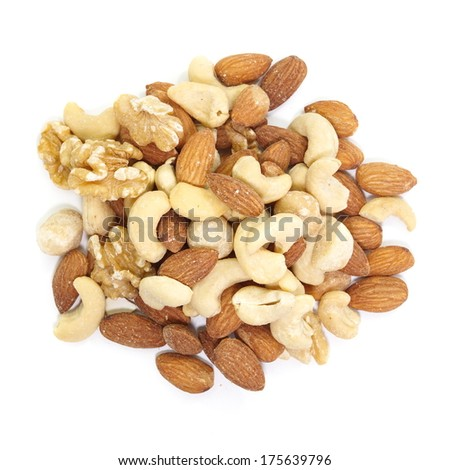 Mix of nuts close - up on white background  - stock photo