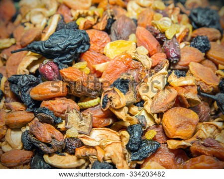 Mix of of different fruits and dried fruits - stock photo