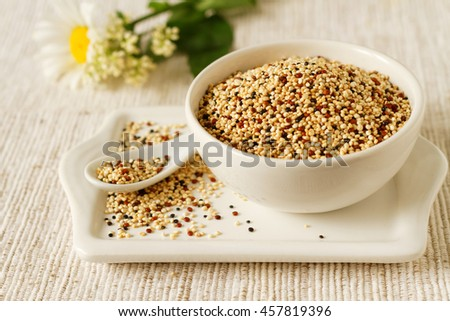 Mix of red, black and white quinoa seeds in a bowl