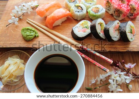 Mix of sushi rolls with soy sauce - stock photo
