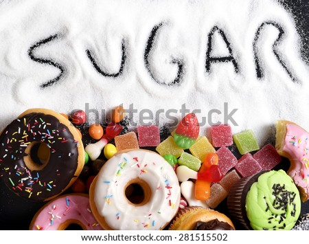 mix of sweet cakes, donuts and candy with sugar spread and written text in unhealthy nutrition, chocolate abuse and addiction concept, body and dental care - stock photo