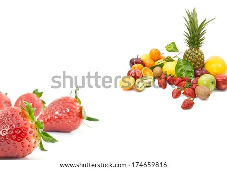 MIX OF TROPICAL FRUIT WITH CLOSE UP STRAWBERRY