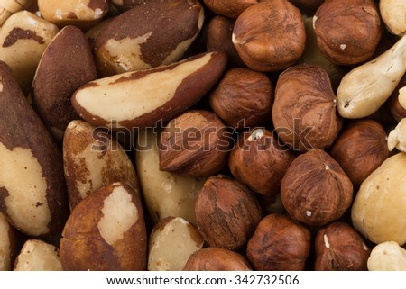mix of various nuts background above closeup - stock photo