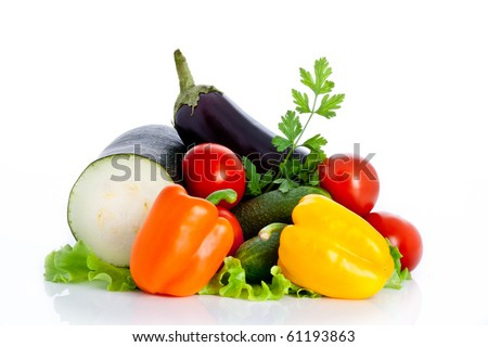 mix of vegetables on salad isolated on white background - stock photo