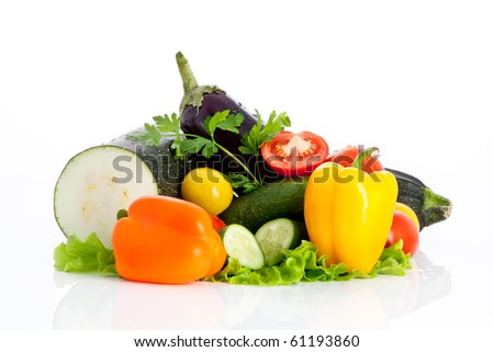 mix of wet vegetables on salad with cut tomatoes and cut cucumber isolated on white background
