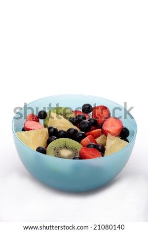 mix slice fruit in a sweet blue bowl.