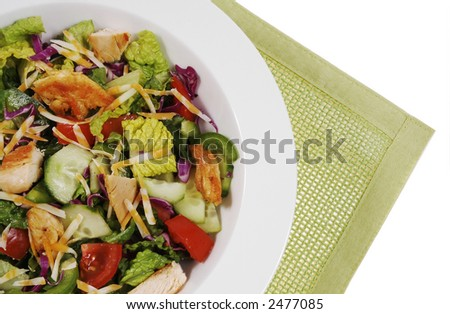 Mix vegetable salad with grilled chicken breast and cheddar cheese