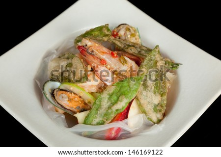 Mixed and spicy seafood salad with crispy vegetable.