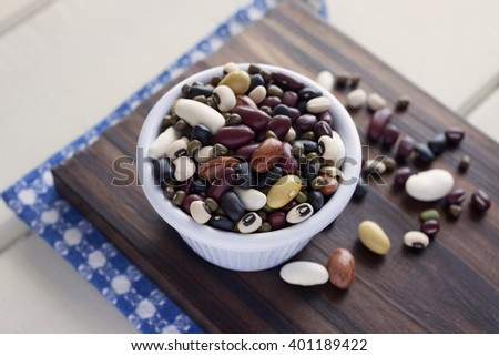 Mixed Beans. High angle view of white bowl full of Mixed Beans. Very shallow depth of field. - stock photo