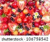Mixed berries - strawberries, blueberries and cherries on white background - stock photo