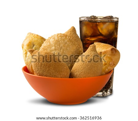 Mixed Brazilian deep fried chicken snack,, esfihas and pastry with soda. popular at local parties.  - stock photo