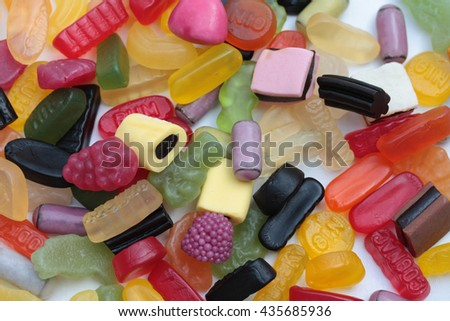 Mixed candy in various colors, shapes and sizes