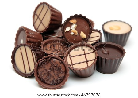Mixed Chocolates heap against a white background ( candy basket ) - stock photo