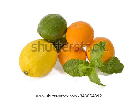 Mixed citrus fruits with mint isolated on white background