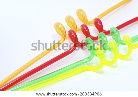 Mixed, colored, turbinated straws on the white background.  - stock photo