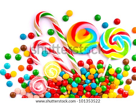 Mixed colorful candies isolated on white - stock photo