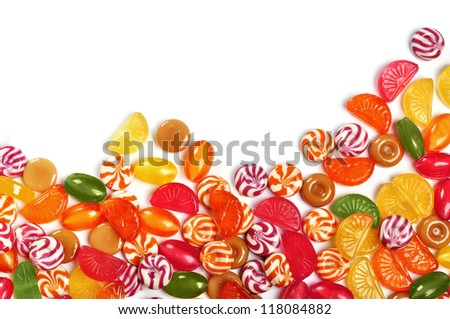 Mixed colorful fruit candy closeup over white background